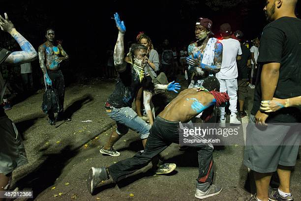 Revelers participate in Jouvert an annual Caribbean street festival celebrated each Labor Day September 7 2015 in the Brooklyn borough of New York...
