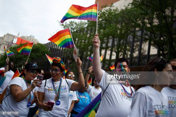 Revelers participate in the Philadelphia LGBT Pride Parade through the city's 'Gayborhood' and downtown historic district