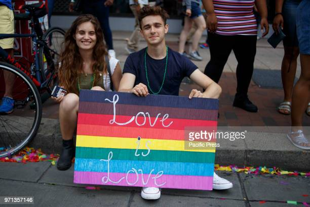 Revelers participate in the Philadelphia LGBT Pride Parade through the city's Gayborhood and downtown historic district