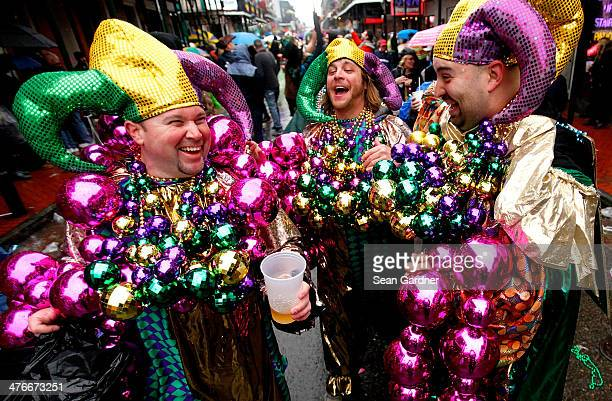 Revelers party in the French Quarter despite the rain on Mardi Gras Day on March 4 2014 in New Orleans Louisiana Fat Tuesday or Mardi Gras in French...