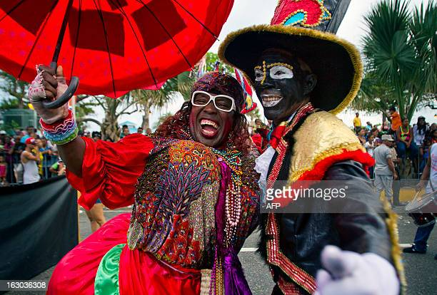 Revelers perform during a carnival parade in Santo Domingo on March 3 2013 AFP PHOTO / ERIKA SANTELICES