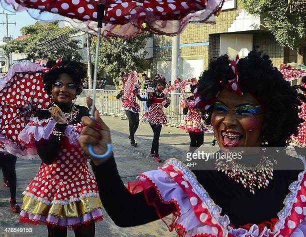 Revelers perform during the Carnival parade in Barranquilla Colombia on March 3 2014 Barranquilla's Carnival a tradition created by locals at the end...