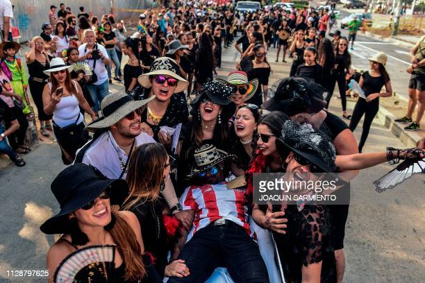 """Revelers perform during """"The death of Joselito Carnaval"""" during last day celebrations in Barranquilla, Colombia on March 5, 2019."""
