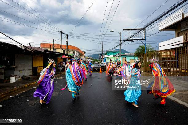 Revelers perform during the traditional Historiantes dance amid Coronavirus pandemic on August 9 2020 in San Salvador El Salvador Number of positive...