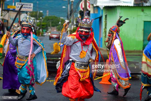 Revelers perform in the traditional Historiantes dance as part of international Indigenous day amid Coronavirus pandemic on August 9 2020 in San...