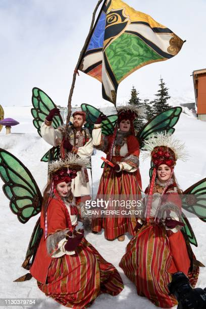 Revelers pose as they attend the first winter edition of the Tomorrowland electronic music festival in l'Alpe d'Huez eastern France on March 13 2019