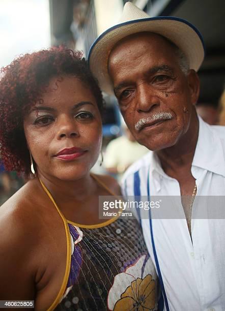 Revelers pose at a traditional samba and feijoada party held at the Portela Samba School in the Madureira neighborhood during preCarnival...