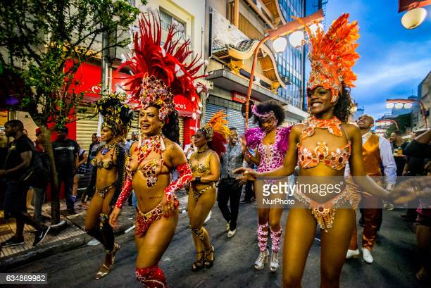 Revelers pose during street Carnival celebrations Street carnival in Sao Paulo many groups called blocos has bands and thousands of revelers costumed...