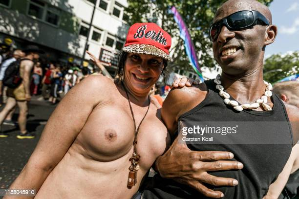 Revelers pose during the annual Christopher Street Day parade on July 27 2019 in Berlin Germany This year's CSD is celebrating the 50th anniversary...