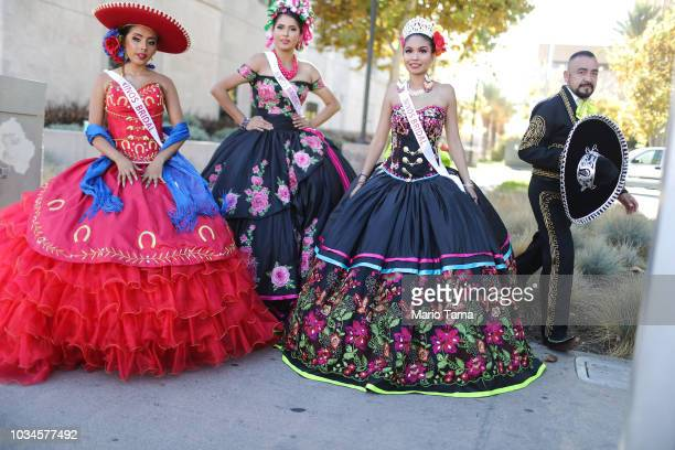 Revelers pose for photographers after marching in a parade marking Mexican Independence Day on September 16 2018 in Santa Ana California 116 million...