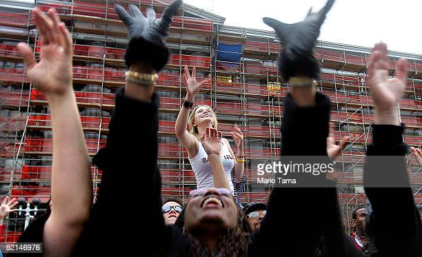 Revelers reach in the air for beads tossed from a float during a Mardi Gras parade February 6 2005 in New Orleans Louisiana Festivities will continue...