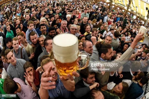 Revelers receive free beer in the Paulaner tent on the first day of the 2017 Oktoberfest beer fest on September 16 2017 in Munich Germany Oktoberfest...