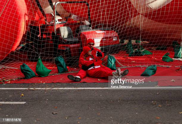 Revelers rest as they get ready before the annual Macy's Thanksgiving parade on November 28 2019 in New York City
