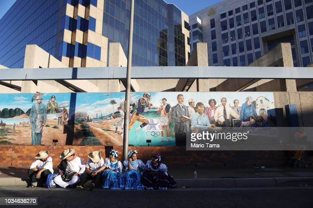 Revelers rest by a mural on the parade route during a parade marking Mexican Independence Day on September 16 2018 in Santa Ana California 116...