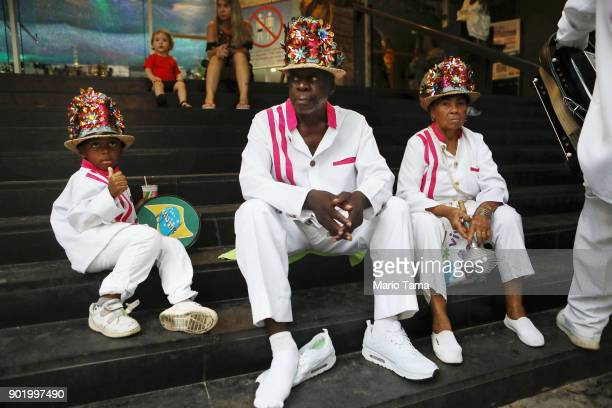 Revelers sit on church steps after performing during Three Kings Day celebrations on January 6 2018 in Rio de Janeiro Brazil Three Kings Day...