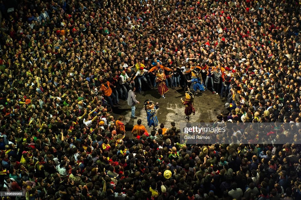 Revelers surround the 'Nans Vells', 'old dwarves' in Catalan, during the first day of 'La Patum' Festival on May 30, 2013 in Berga, Spain. The Patum festival's roots are found in the theatrical performances of the Middle Ages and is held in the town of Berga each year during the week of Corpus Christi.