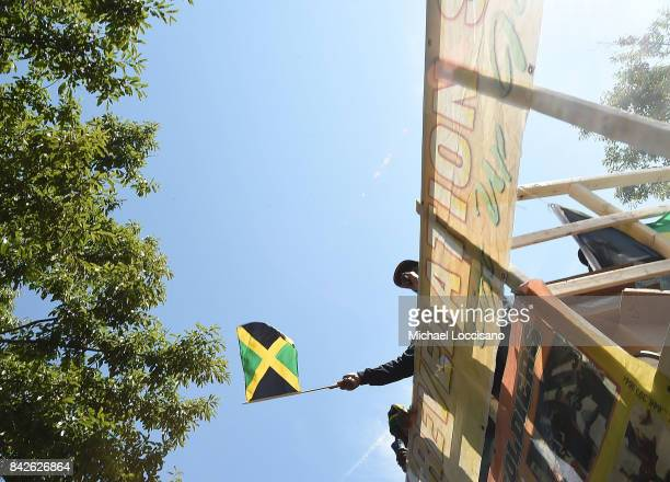 Revelers take part and wave the flag of Jamaica during the West Indian American Day Parade celebrating Caribbean Carnival on September 4 2017 in the...