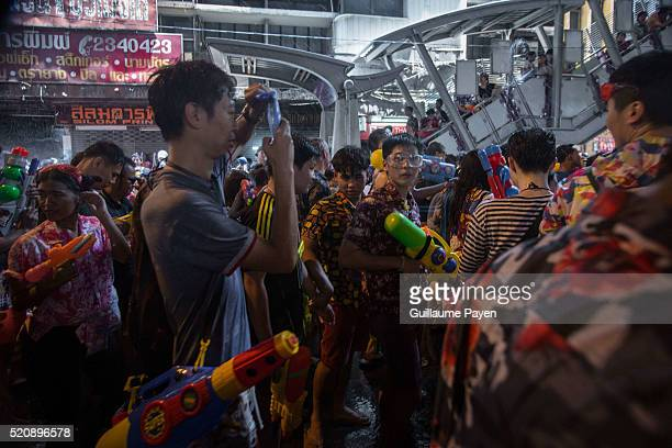 Revelers take part in a water fight as they celebrate the Thai Traditional New Year, known as the Songkran festival, on Silom Road. The Songkran...