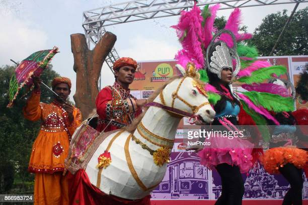 Revelers take part in at International puppet festival in Kolkata India on 26 October 2017