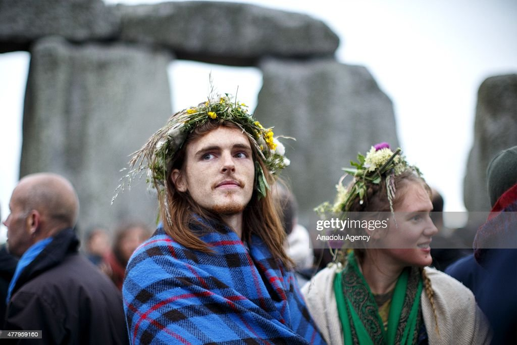 Revelers take part in celebrations to mark the summer solstice at Stonehenge prehistoric monument on June 21, 2015 in Wiltshire, England. Thousands of revellers gather at the 5,000 year old stone circle in Wiltshire to see the sunrise on the Summer Solstice dawn. The solstice sunrise marks the longest day of the year in the Northern Hemisphere.