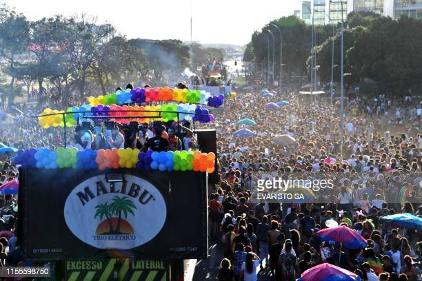 """Revelers take part in the 22nd LGBT Pride Parade, which theme is """"50 years of Stonewall"""", in Brasilia, on July 14, 2019."""