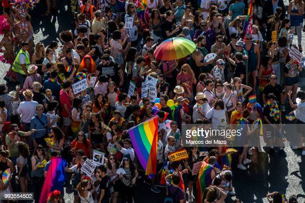 Revelers take part in the Gay Pride 2018 parade