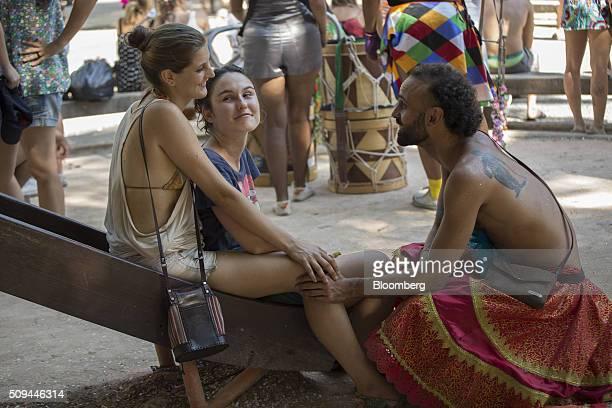 Revelers talk during the Bloco das Mulheres Rodadas Carnival parade in Rio de Janeiro, Brazil, on Wednesday, Feb. 10, 2016. The Bloco das Mulheres...