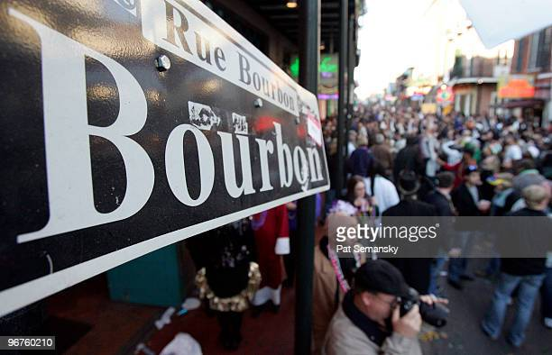 Revelers walk along Bourbon Street in the French Quarter during Mardi Gras day on February 16, 2010 in New Orleans, Louisiana. The annual Mardi Gras...