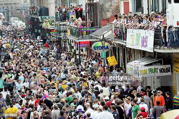 Revelers walk along Bourbon Street on Mardi Gras Day, February 20, 2007 in New Orleans, Louisiana. This is the second Mardi Gras celebration since...