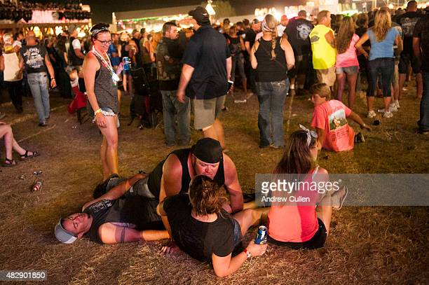 Revelers watch a concert at the Sturgis Buffalo Chip campground August 3 2015 in Sturgis South Dakota This year marks the 75th anniversary of the...