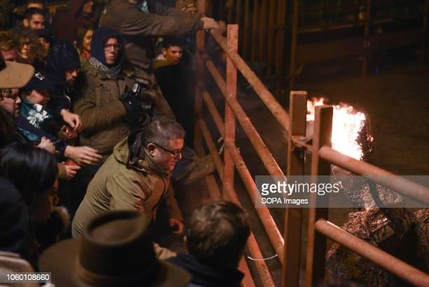 Revelers watch a fire bull during the 'Toro de Jubilo' Fire Bull Festival in Medinaceli 'Toro de Jubilo' is an ancient tradition from the bronze age...