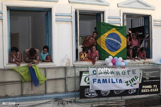Revelers watch the group Filhos de Gandhy parade in Salvador on February 14 2010 in Salvador Brazil Filhos de Gandhy means Sons of Gandhy as it...