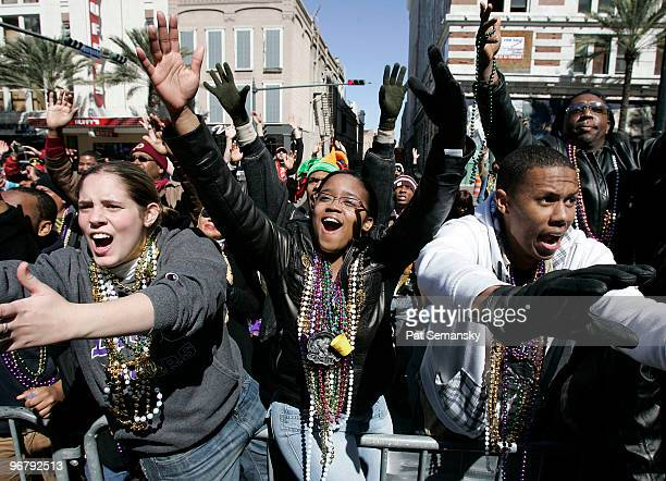 Revelers wave and yell for beads during Mardi Gras day on February 16 2010 in New Orleans Louisiana The annual Mardi Gras celebration ends at...