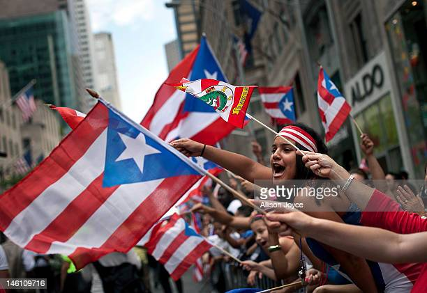 Revelers wave flags along Fifth Avenue during the Puerto Rican Day Parade on June 10 2012 in New York City The Puerto Rican Day Parade draws hundreds...