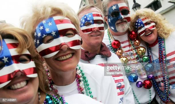Revelers wear American flag masks on Bourbon Street during Mardi Gras festivites February 6 2005 in New Orleans Louisiana Festivities will continue...