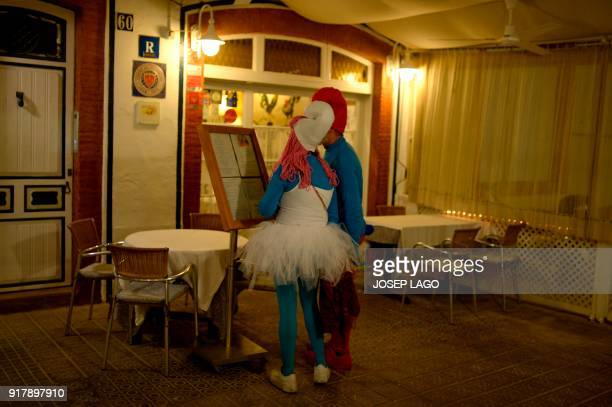 TOPSHOT Revelers wearing Smurfs costumes look at the menu of a restaurant during Sitges Gay Carnival on February 13 2018 in Sitges near Barcelona /...