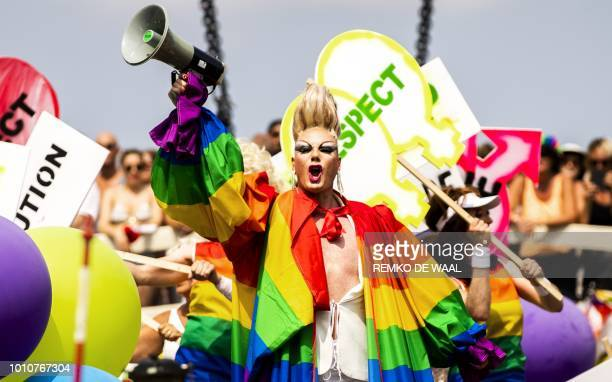 TOPSHOT A reveller aboard a boat takes part in the annual Gay Pride parade in Amsterdam in August 4 2018 / Netherlands OUT
