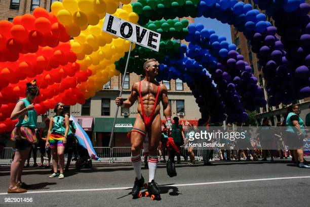 A reveller attends the annual Pride Parade on June 24 2018 in New York City The first gay pride parade in the US was held in Central Park on June 28...