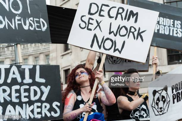 A reveller calls for a decriminalisation of sex work during the Pride 2019 parade on 06 July 2019 in London England The festival which this year...