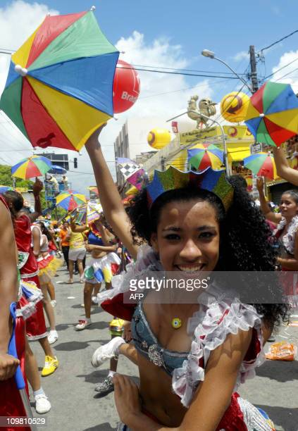 A reveller dances the traditional frevo an accelerated polkalike dance during Recife's Carnival in the northeastern state of Pernambuco on March 6...