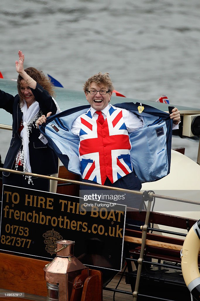 A reveller displays his Union Flag waistcoat during the Thames Diamond Jubilee River Pageant on June 3, 2012 in London, England. For only the second time in its history the UK celebrates the Diamond Jubilee of a monarch. Her Majesty Queen Elizabeth II celebrates the 60th anniversary of her ascension to the throne. Thousands of well-wishers from around the world have flocked to London to witness the spectacle of the weekend's celebrations. The Queen along with all members of the royal family will participate in a River Pageant with a flotilla of a 1,000 boats accompanying them down The Thames.