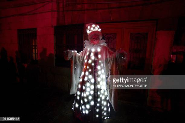 TOPSHOT A reveller dressed in mask and period costume takes part in the opening ceremony of the traditional Venice Carnival on January 27 2018 The...