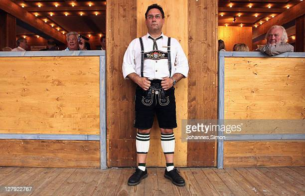 A reveller dressed with traditional Bavarian costume attends the last day of Oktoberfest beer festival on October 2 2011 in Munich Germany