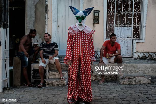 A reveller during a parade on the last day of carnival in Madre de Deus Bahia State Brazil on February 9 2016 'Bloco da Latinha members mostly...