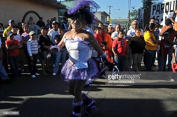 A reveller in costume dances during the traditional 'Convite de fieros' festival part of All Saints Day celebrations in Villa Nueva 15 km south of...