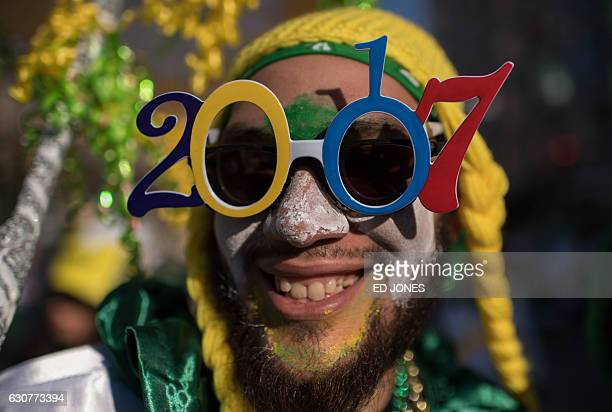 A reveller in fancy dress poses for a photo during the annual Mummers Parade in Philadelphia on January 1 2017 The Mummers Parade is a 120yearold...