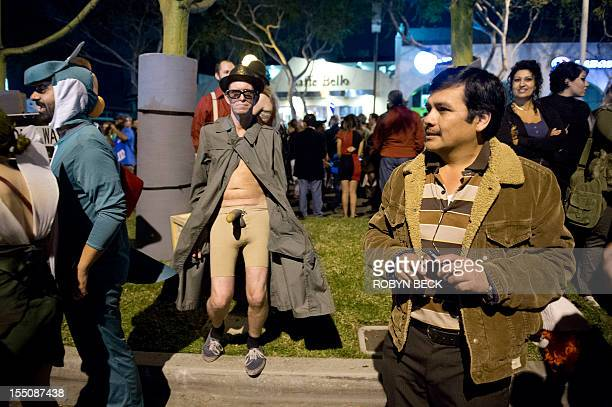 A reveller is dressed as a flasher on Santa Monica Blvd during the annual Halloween Carnaval in West Hollywood California on October 31 2012...
