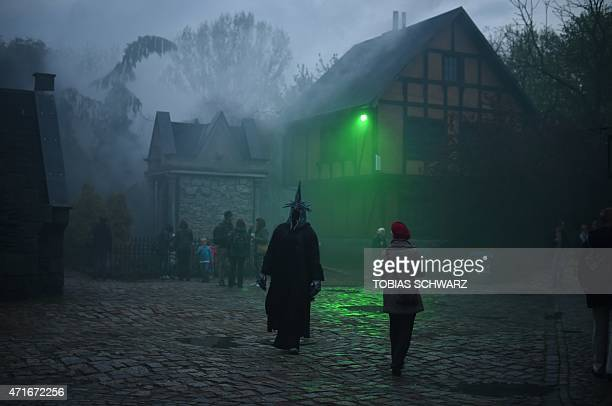 A reveller is dressed to take part in Walpurgis Night celebrations at the film park in Babelsberg Potsdam near Berlin on April 30 2015 Walpurgis...