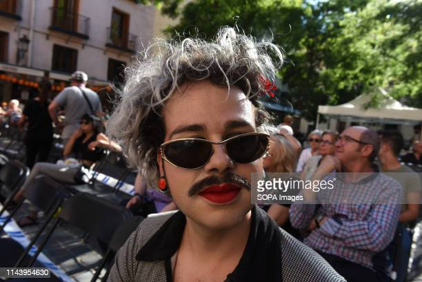 A reveller is seen during the 'Reinventando Chulap's fashion contest in Madrid Reinventando Chulaps is celebrated during the festivities in honour of...