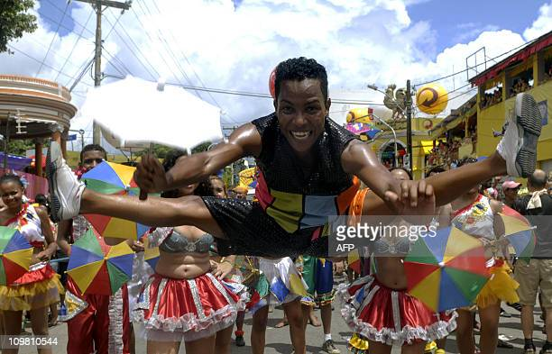 A reveller jumps while dancing the traditional frevo an accelerated polkalike dance during Recife's Carnival in the northeastern state of Pernambuco...